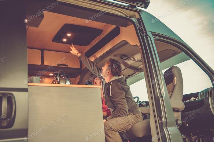 Men Turning Off Camper Van Air Condition Unit