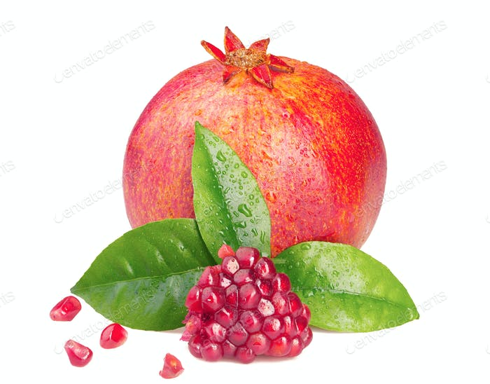 Ripe pomegranate with a leaf on white background