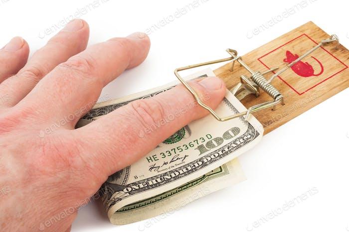 Hand und Mausefalle mit Geld