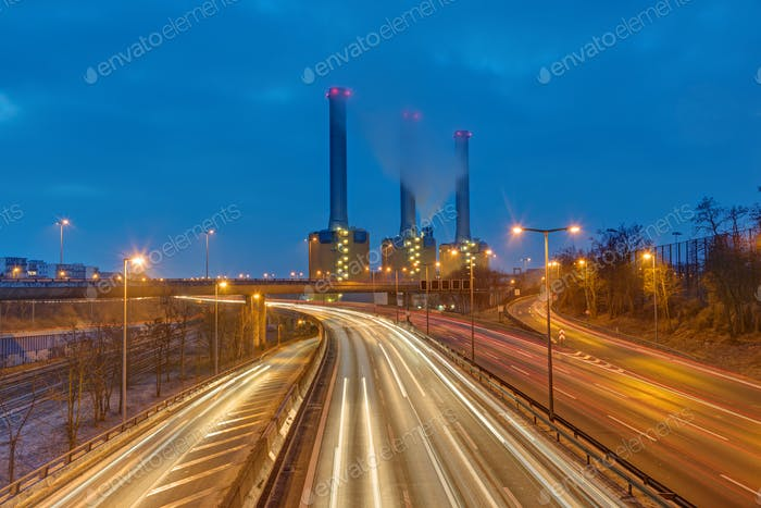 Power station and highway at night