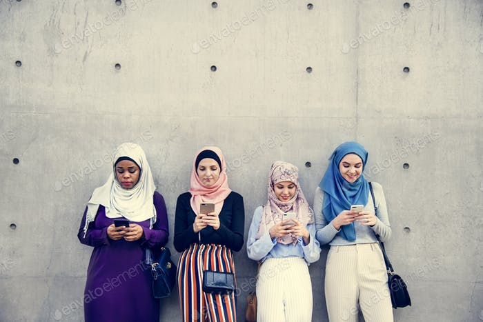 Group of islamic girls using smart phone