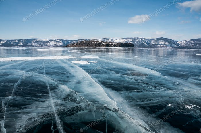 scenic view of frozen river with snowy mountains in winter, Russia, Lake Baikal, march 2016