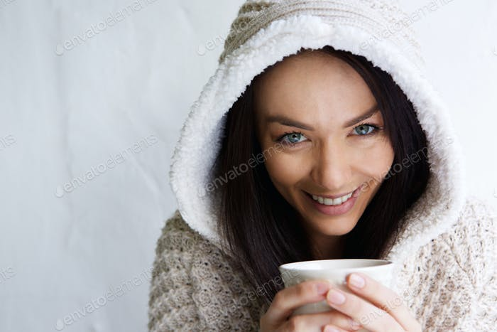 Attractive young lady enjoying a cup of coffee