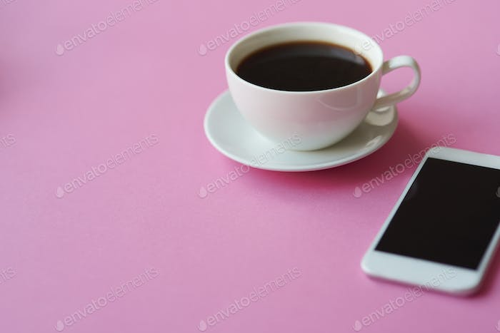Close up of black coffee and smartphone