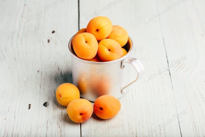 Mellow apricots in metal mug