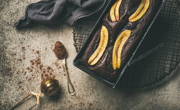 Chocolate banana cake with cinnamon in baking tin, horizontal composition