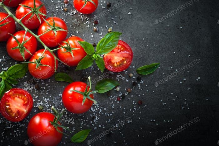 Fresh cherry tomatoes on a black