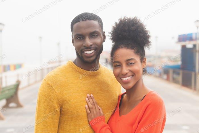 Couple standing at promenade near sea side