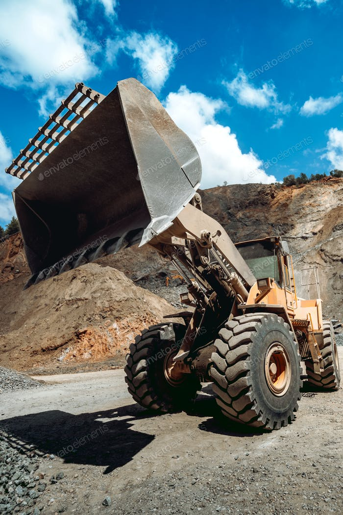 Wheel loader working at gravel during mining operations