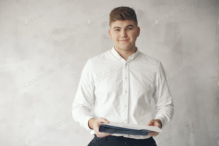 Stylish businessman working in a office and use the phone