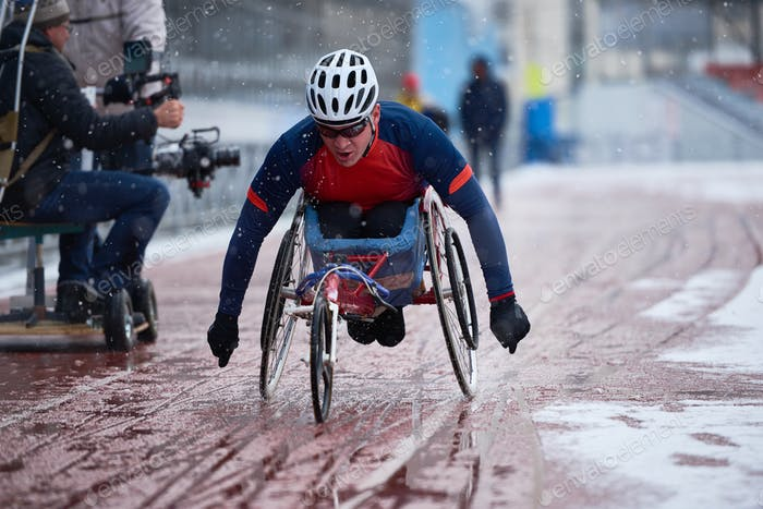 Male athlete with disability participating in wheelchair racing competition
