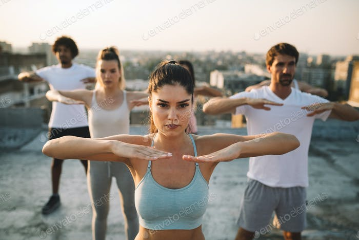 Fitness, sport, friendship and healthy lifestyle concept - group of happy sporty friends