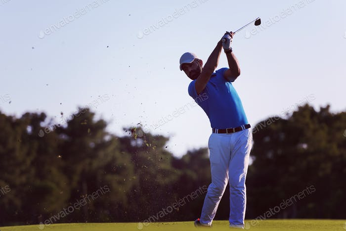 golfer hitting long shot