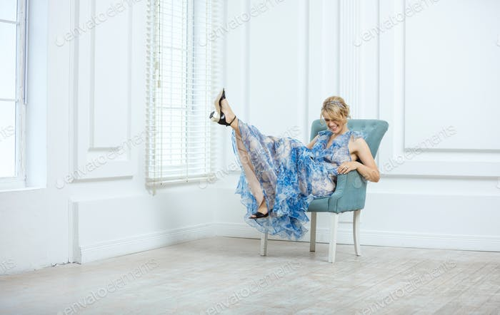 Young woman in fashionable dress having fun indoors