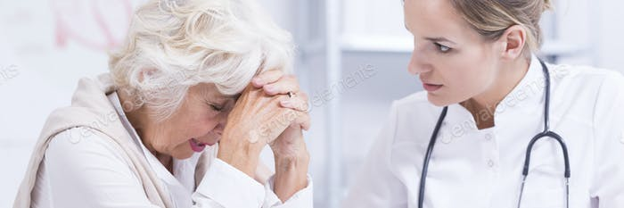 Worried older woman and the doctor