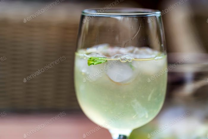 Refreshing Mojito cocktail in glass close
