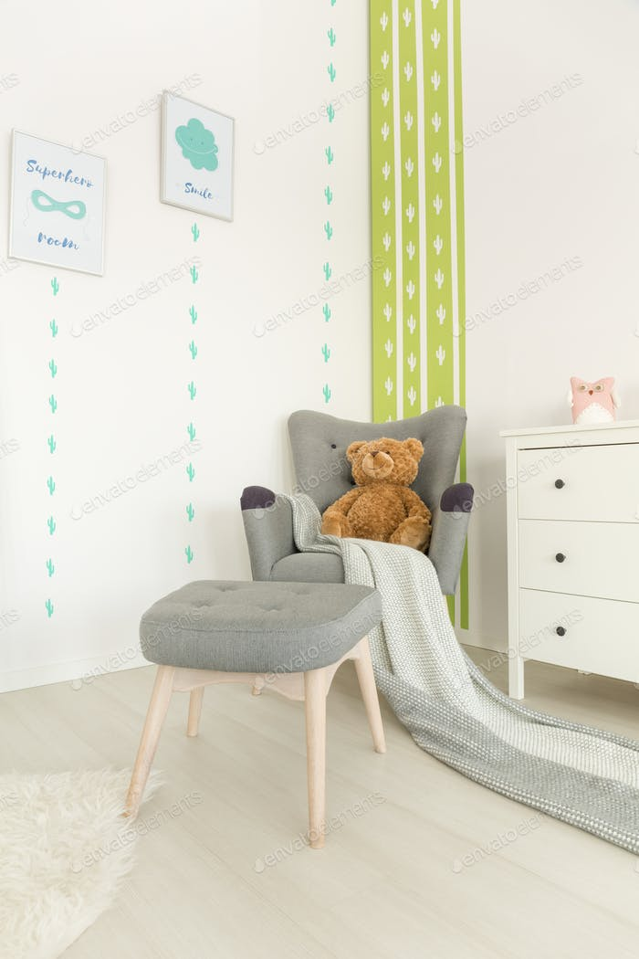 Scandi baby room with armchair