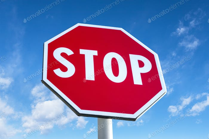 Stop traffic sign with clear blue sky