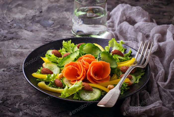 Vegetable salad with carrot, cucumber, pepper, almond and chick-pea