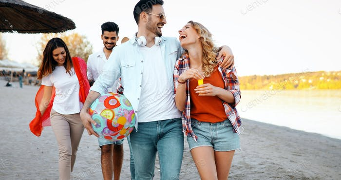 Group of young cheerful people bonding to each other and smiling
