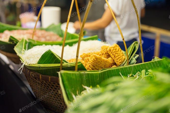 Noodles And Veggies Displayed In Food Market