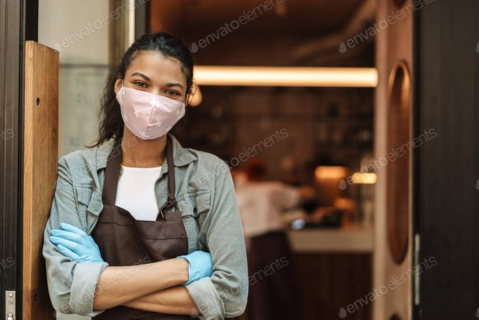 Woman cafe owner with face mask