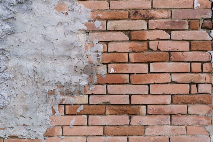 Strukturierter Hintergrund der abstrakten braunen Mauer