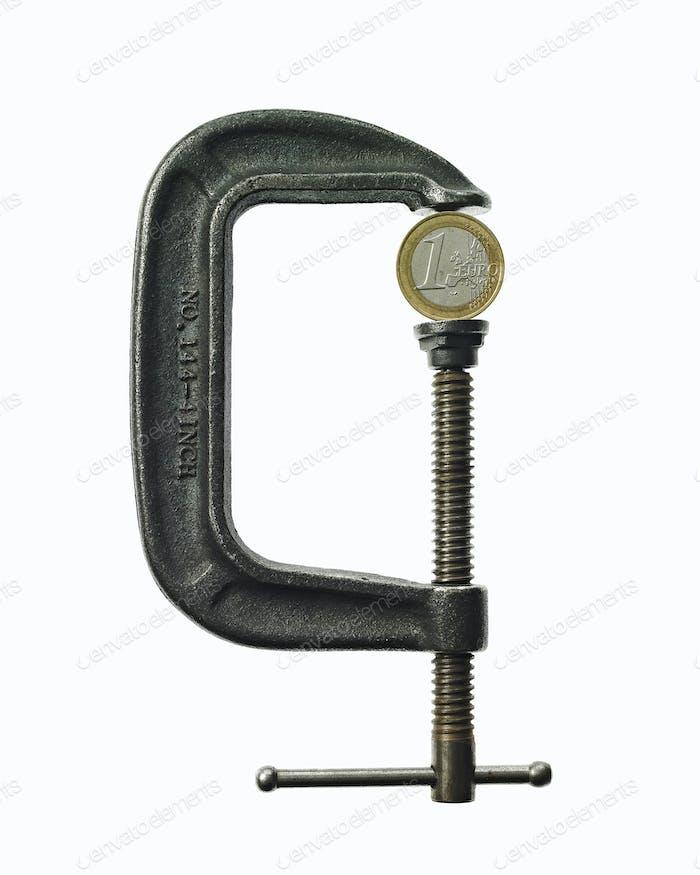 A coin in a clamp, conceptual shot.
