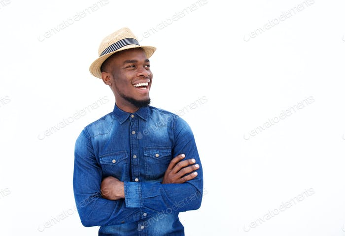 Cheerful young man standing with hat