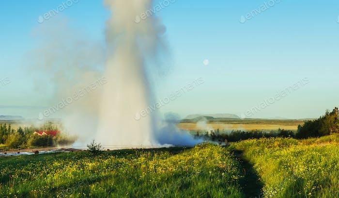 Fantastic sunset Strokkur geyser eruption in Iceland