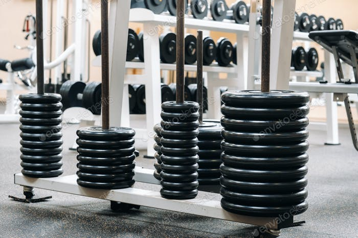 barbell discs stacked in rows in the gym