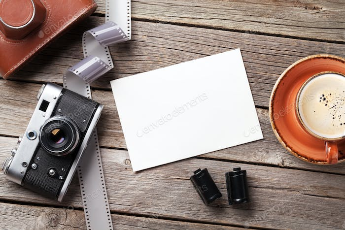 Vintage camera and blank photo frame