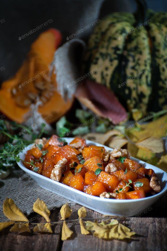 A tender baked pumpkin with honey, nuts and thyme leaves. Shooti