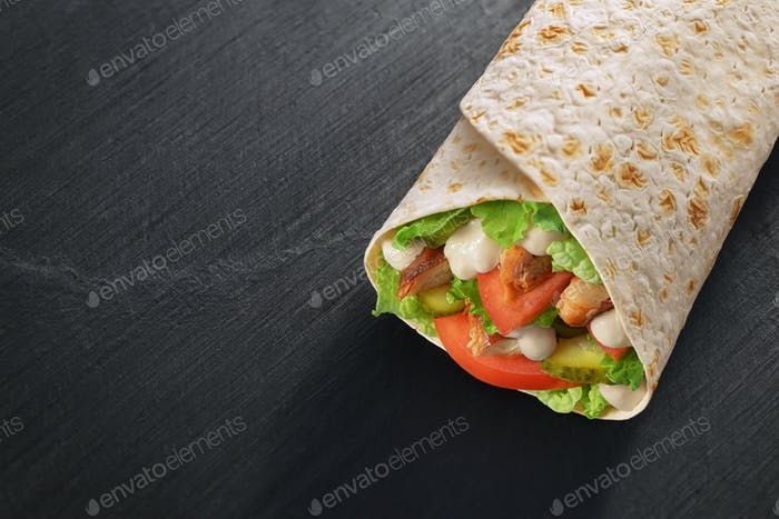 Wrap sandwich on dark black slate texture