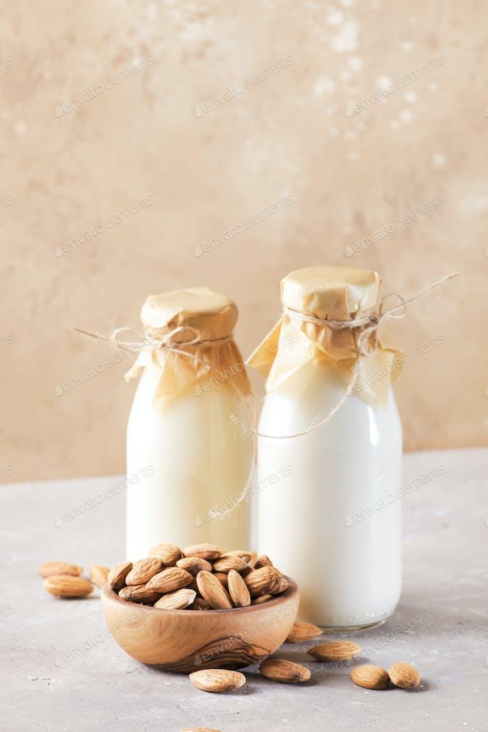 Vegan almond milk and cream in bottles
