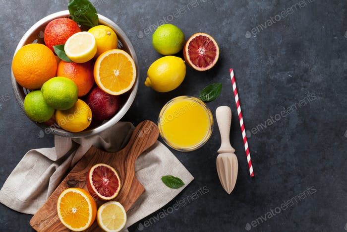 Fresh ripe citruses and juice. Lemons, limes and oranges