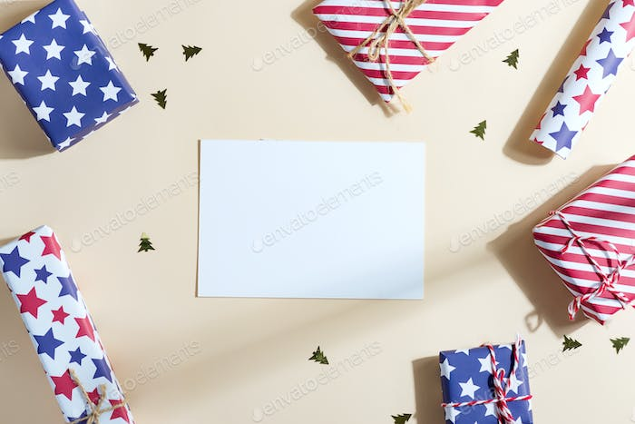 Greeting Christmas mockup card with colorful gift boxes