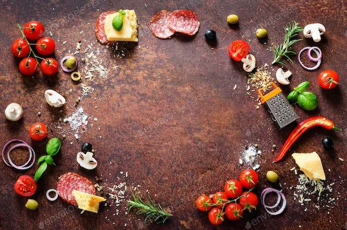 Food ingredients and spices for cooking pizza. Mushrooms, tomatoes, cheese, onion, oil, pepper, salt