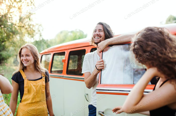 A group of young friends on a roadtrip through countryside.