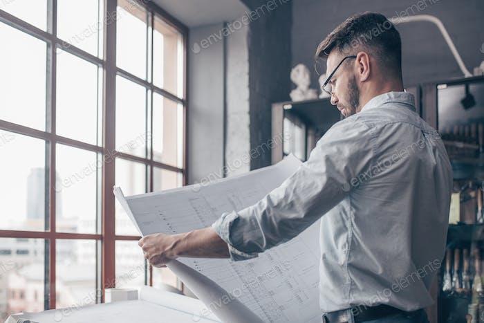 Mature engineer in studio