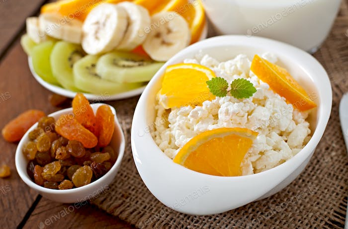 Cottage cheese with orange for breakfast close up
