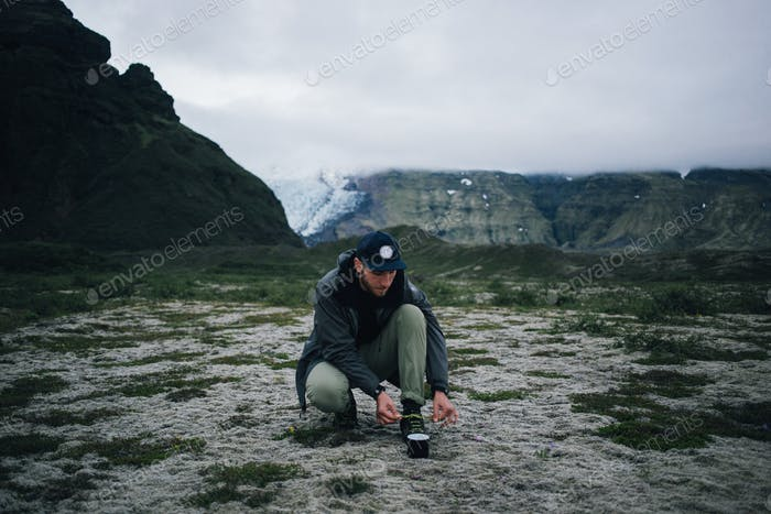 Hipster man mid hike in iceland