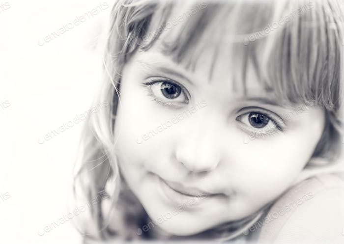 Portrait of a cute little girl in black and white