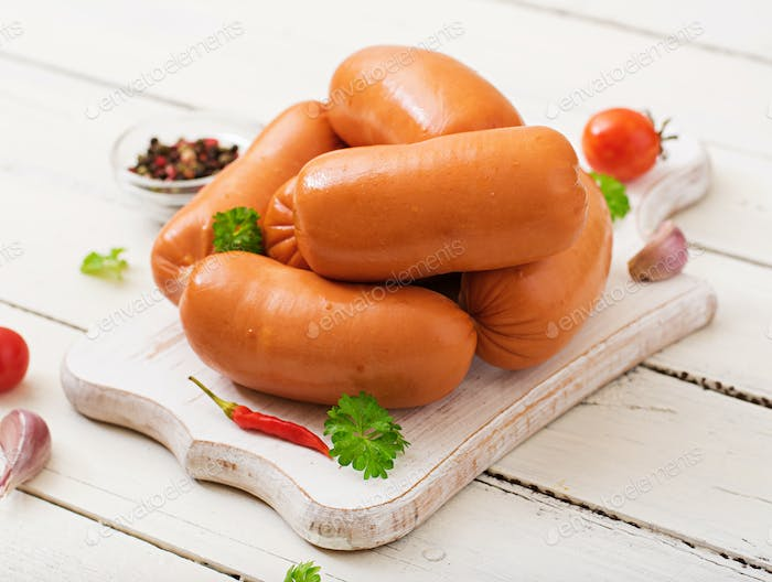 Sausages on a wooden cutting board.