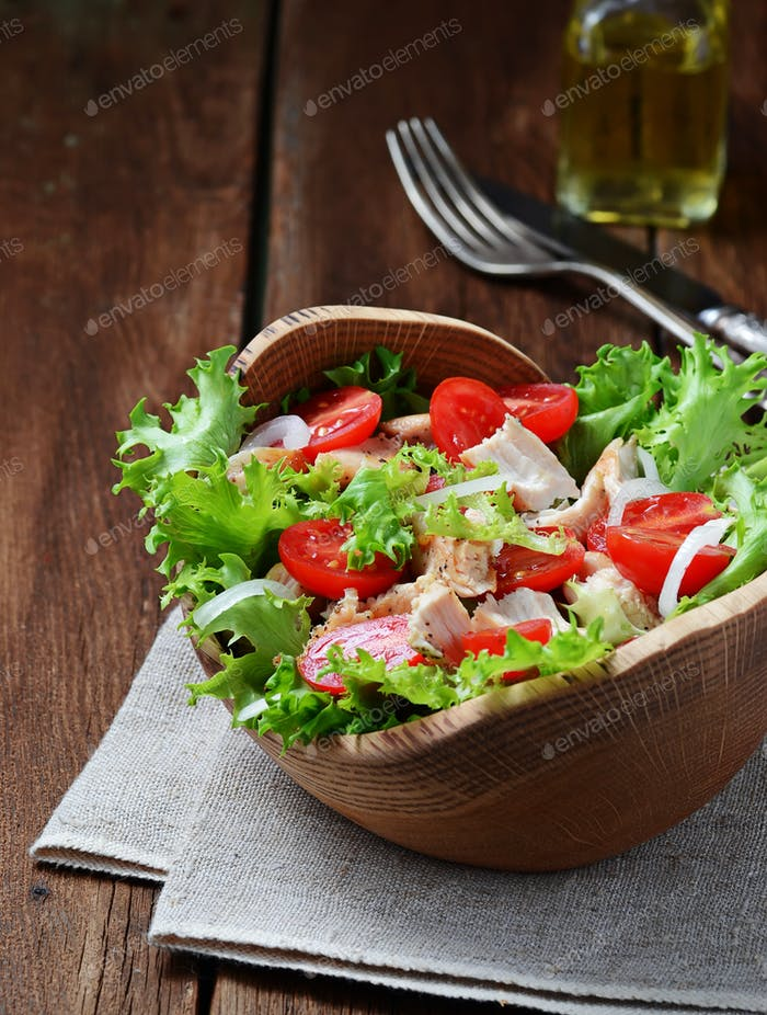 Salad with chicken, tomato cherry and onion