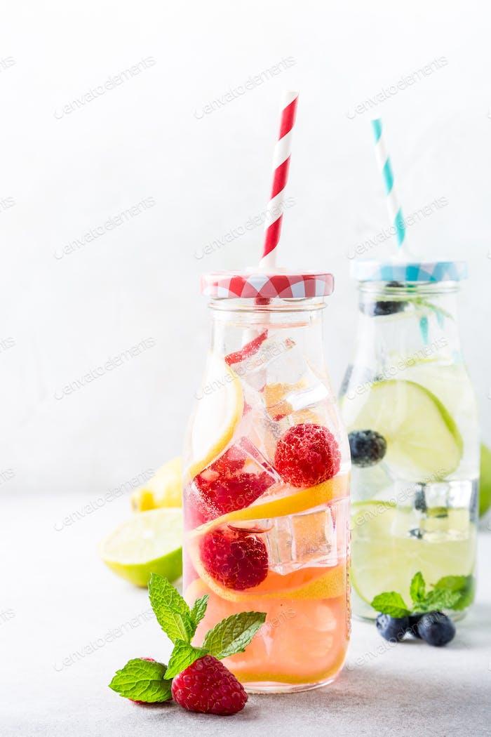 Two glass bottles with lemonade