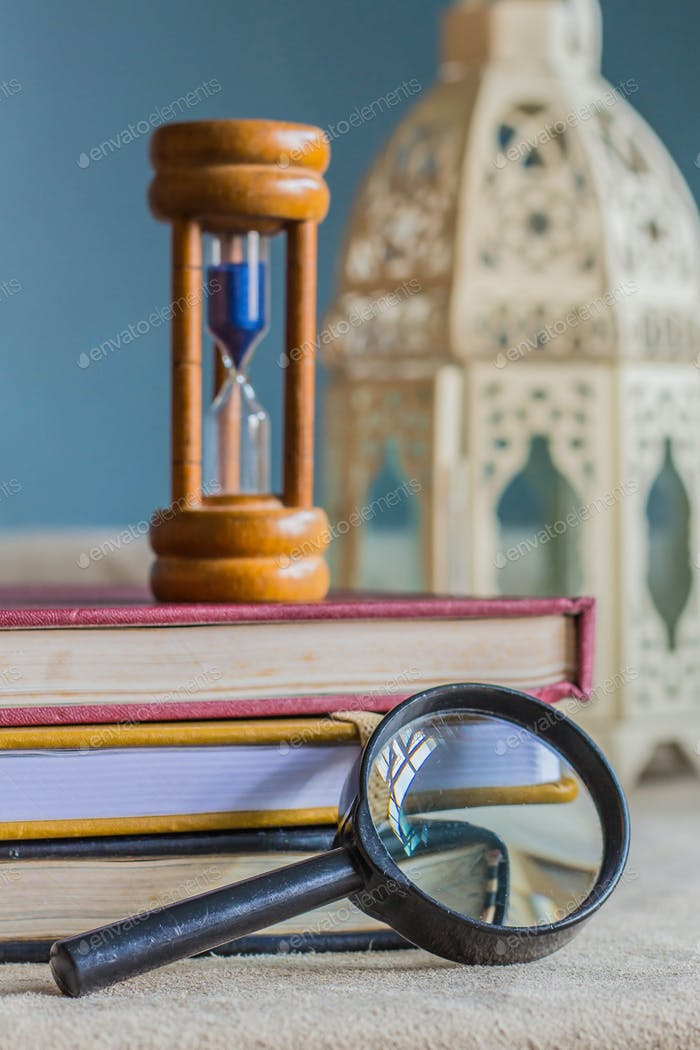 Magnifying glass and hourglass