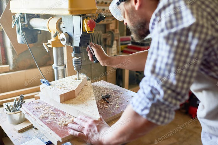 Mature Carpenter Working in Joinery