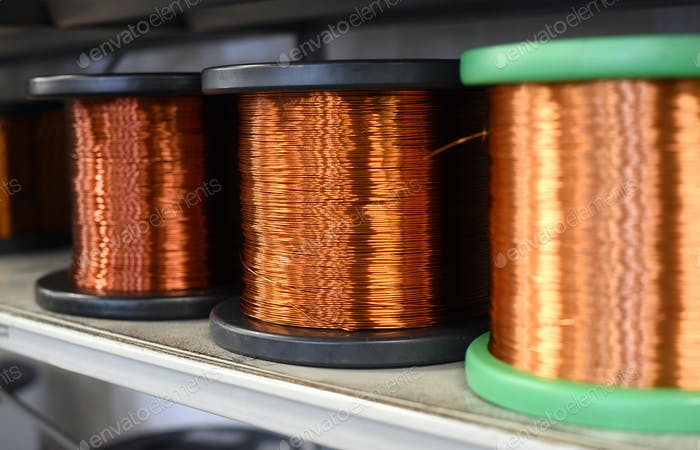 Row of copper wire coils in close up view