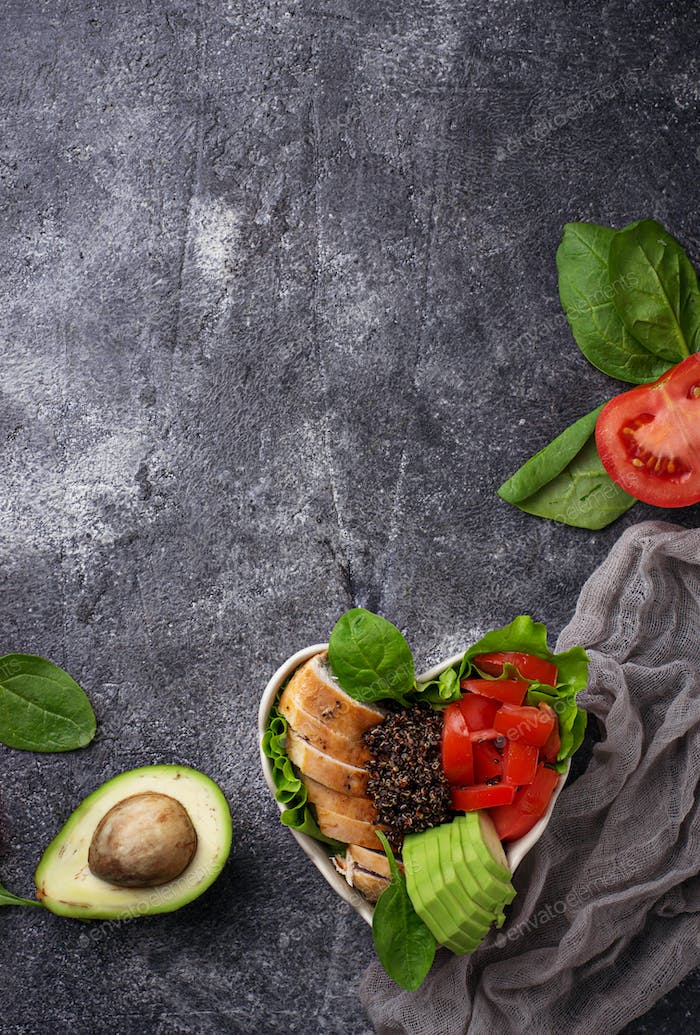 Salad with chicken, black quinoa, tomatoes and avocado